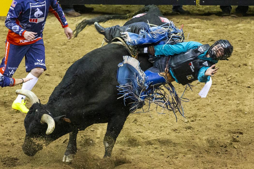Tyler Bingham of Honeyville, Utah, gets sideways on Night Moves in Bull Riding during the fourt ...