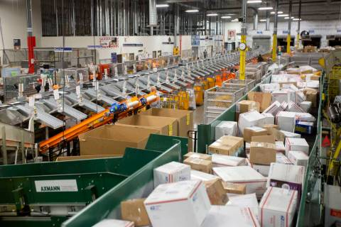 The U.S. Postal Service mail processing annex is full of packages ahead of the holidays on Thur ...