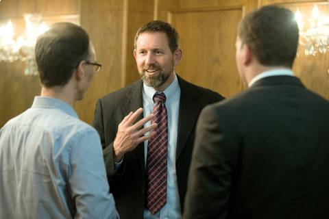 Former Montana Solicitor General Lawrence VanDyke, center, talks with law students Jason Collin ...