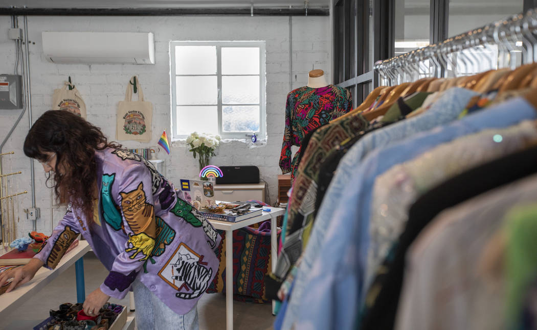 Negar Hosseini-Nasab, founder of Neon Cactus Vintage, arranges products inside the shop at Ferg ...