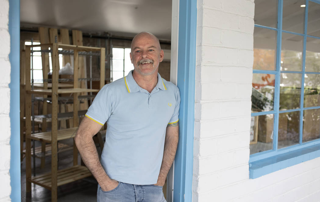Mike Buckham of Mike's Recovery poses for a portrait in the doorway of his new shop at Ferguson ...