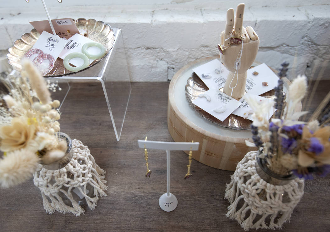 Jewelry and decorations are on the counter at The Tiny Bloom at Fergusons Downtown on Friday, D ...