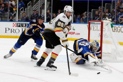 Vegas Golden Knights' Alex Tuch (89) reaches for the puck as St. Louis Blues goaltender Jordan ...
