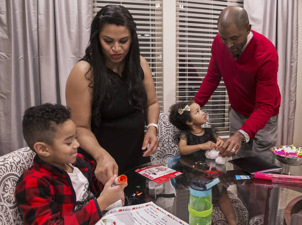 Dr. Sheldon Jacobs, right, daughter Arianna, 3, wife Nicole and son Jayden, 6, make holiday dec ...
