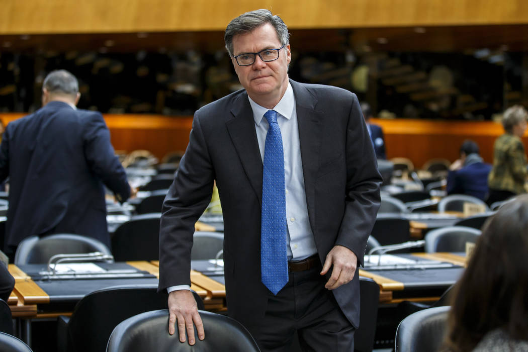 Dennis Shea, US Ambassador to the WTO, arrives for the opening of the General Council, at the h ...