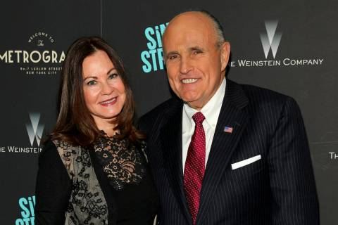 FILE - In this Tuesday, April 12, 2016, file photo, Judith Giuliani, left, and former New York ...