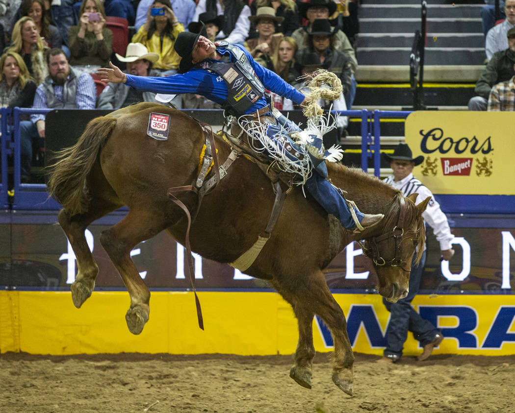 Dawson Hay of Wildwood, Alberta, leans back on Sue City Sue during Saddle Bronc Riding for a fi ...