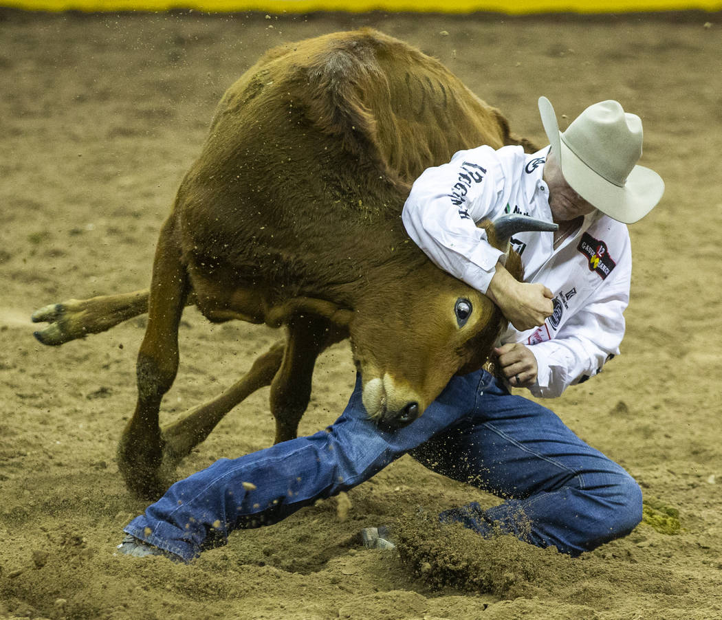 Tyler Waguespack of Gonzales, La., takes control in Steer Wrestling during a first-place run of ...