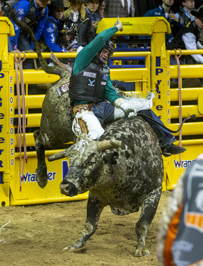 Boudreaux Campbell of Crockett, Texas, rides Priefert's Tequila Worm in Bull Riding to a first ...