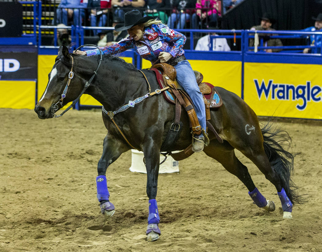 Amberleigh Moore of Salem, Ore,. heads for home in Barrel Racing for a first-place time of 13.5 ...