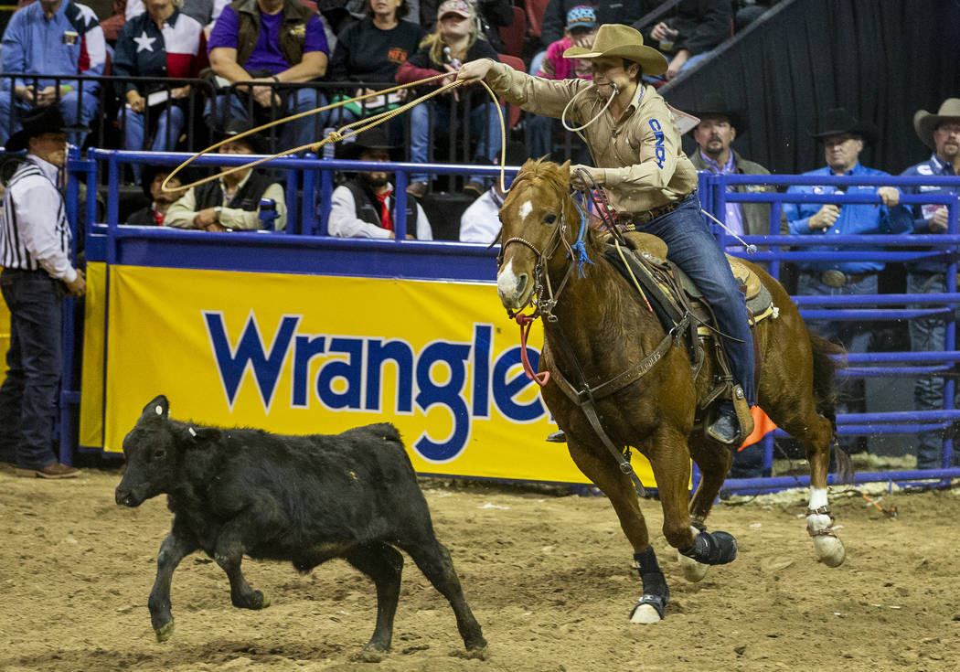 Ty Harris of San Angelo, Texas, bears down on a calf in Tie-Down Roping for a first place time ...