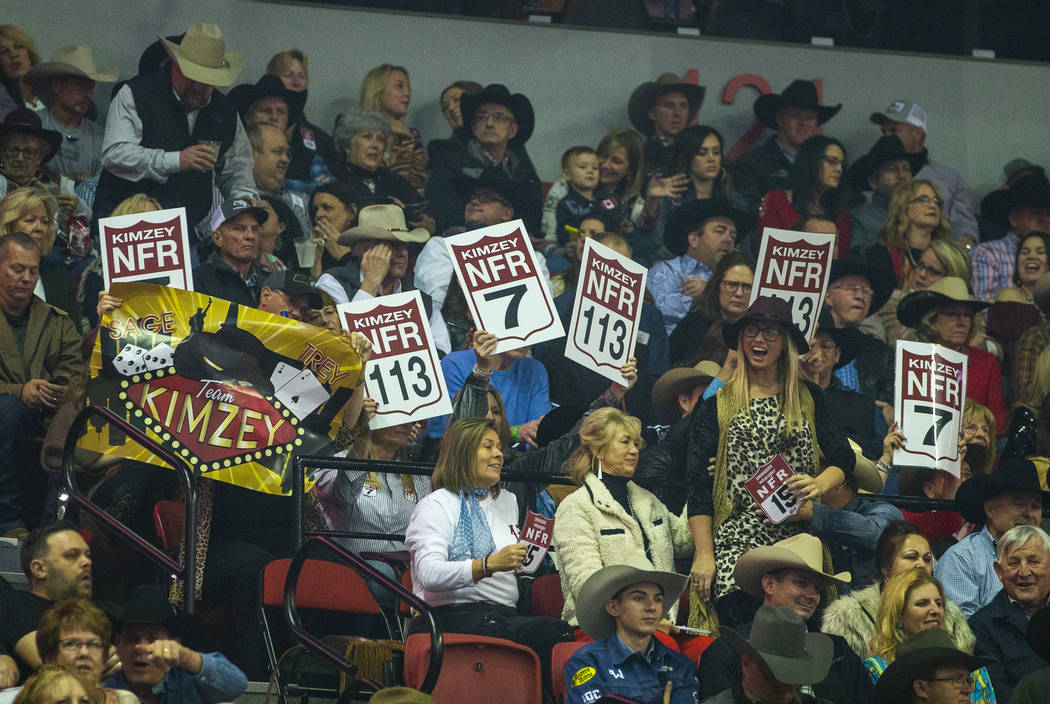Fans cheer for their competitors at the start of the sixth go-round of the National Finals Rode ...