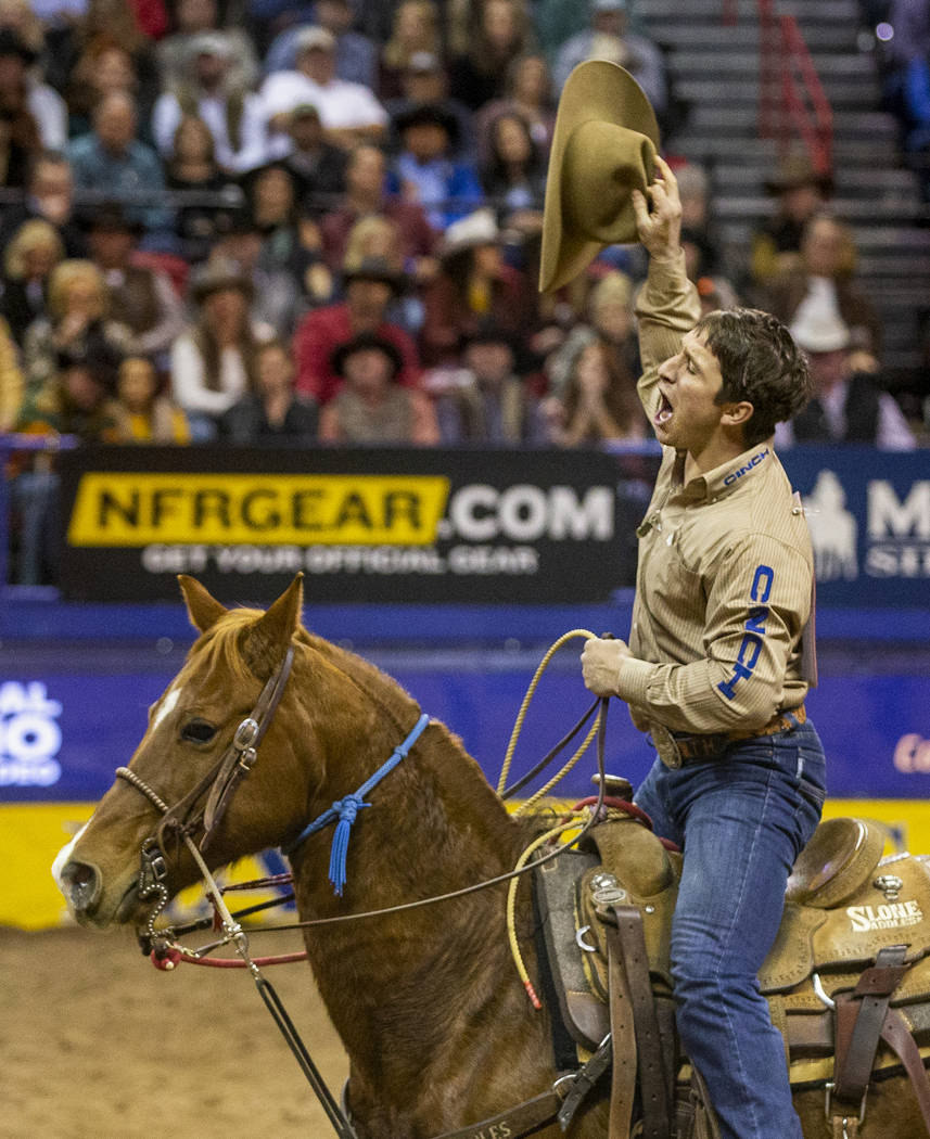 Ty Harris of San Angelo, Texas, celebrates his first place time of 7.10 seconds in Tie-Down Rop ...