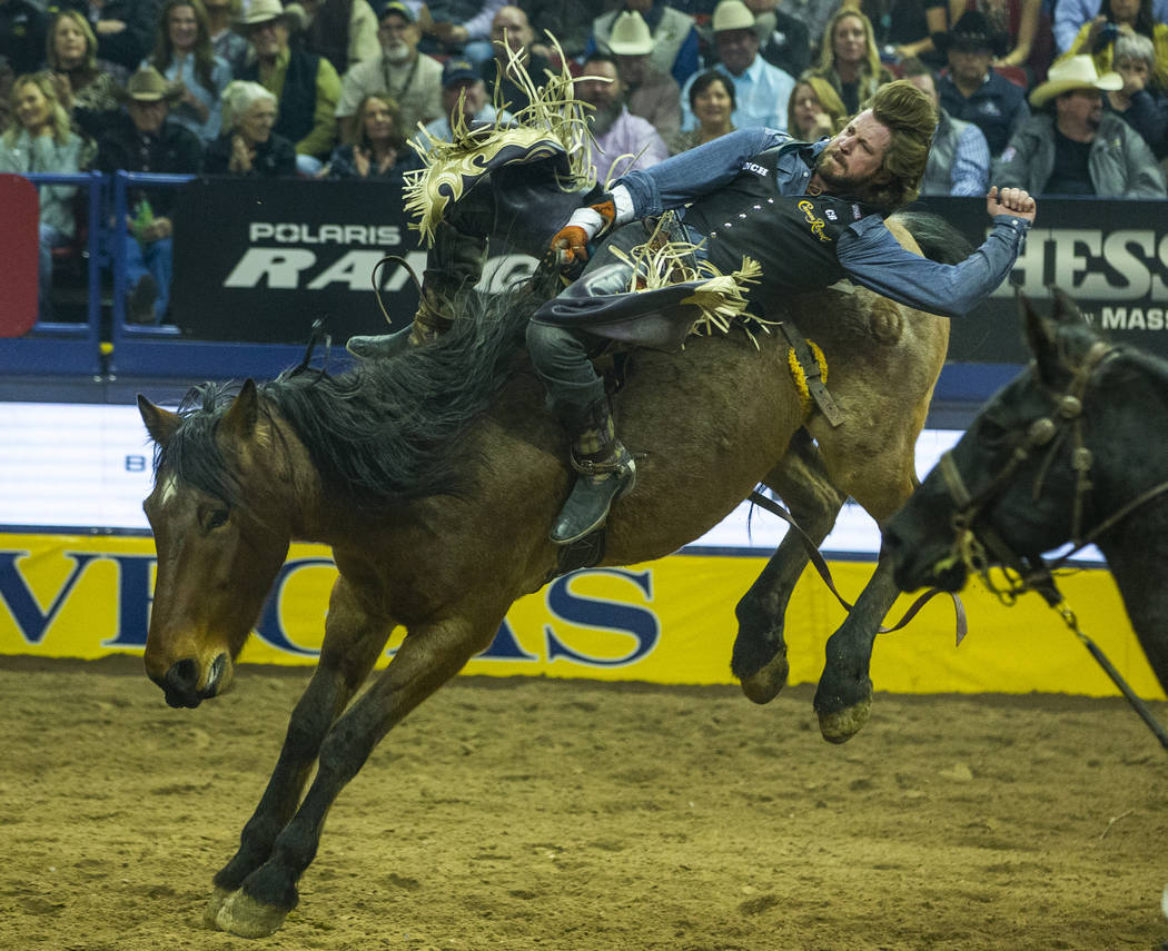 Tilden Hooper of Carthage, Texas, rides Ain't No Angel in Bareback Riding to a first-place tie ...