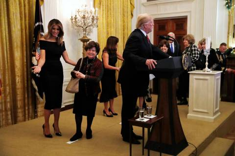 First lady Melania Trump, left, and Karen Pence, wife of Vice President Mike Pence, center, wel ...