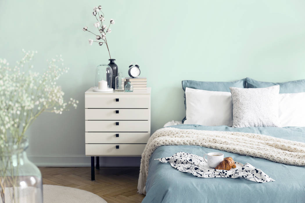 Dunn-Edwards A bedroom interior is painted in Minty Fresh by Dunn-Edwards Paints.