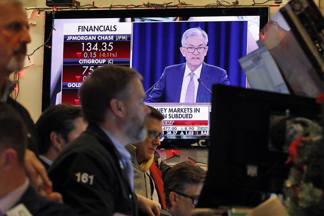 A television screen on the floor of the New York Stock Exchange shows Federal Reserve Board Cha ...