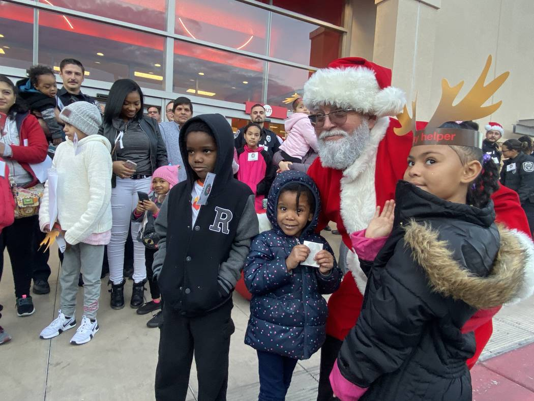 Santa gave a special greeting to more than 40 kids participating in North Las Vegas police's Sh ...