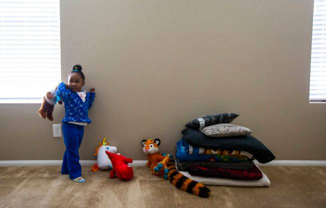 Christine Modica, 3, holds up a stuffed animal in the bedroom she shares with her great-aunt, L ...