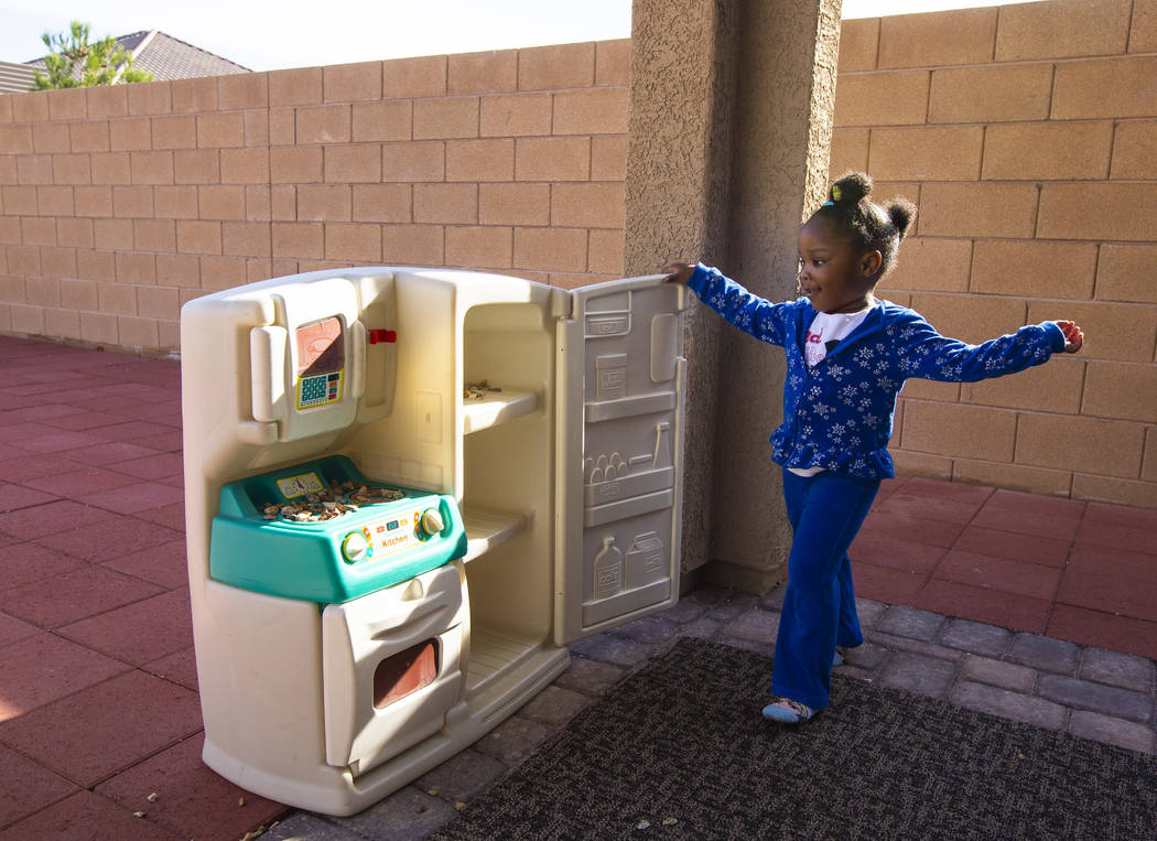 Christine Modica, 3, plays with a toy kitchen set at the home she shares with her great-aunt, L ...