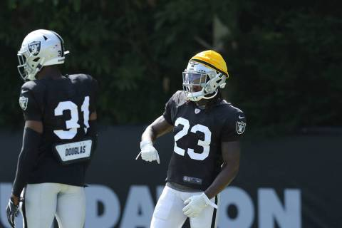 Oakland Raiders cornerbacks Nick Nelson (23) and Isaiah Johnson (31) get ready to drill during ...