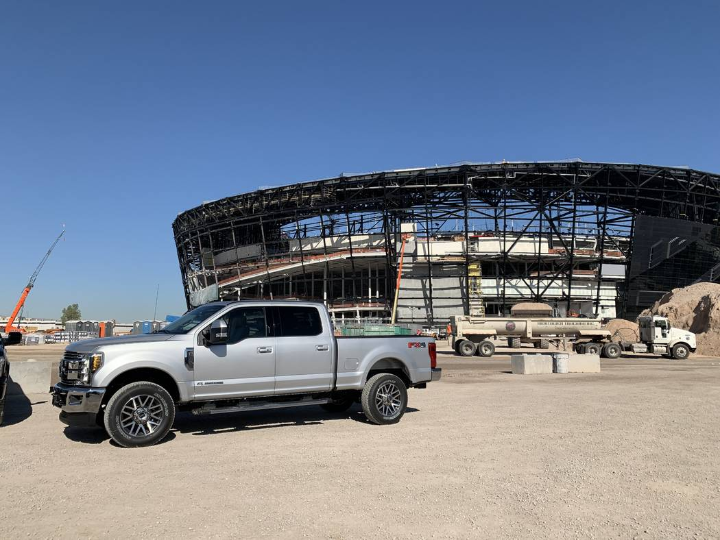 A Ford truck sits in front of Allegiant Stadium in Las Vegas after the company was announced as ...