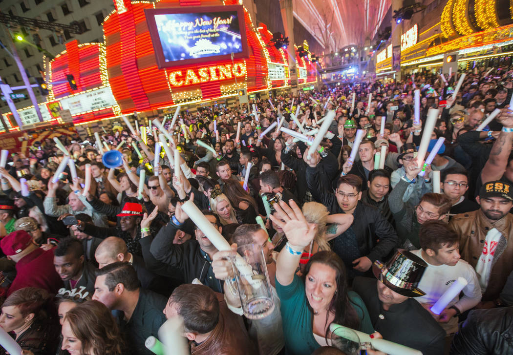 Revelers count down he new year during America's Party on Fremont Street on Saturday, December ...
