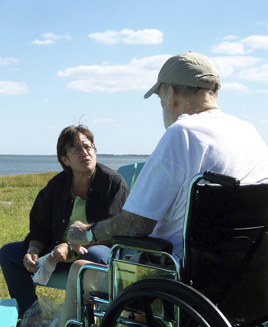 In this Sept. 29, 2009 photo provided by Betsy McNair, Betsy, left, speaks to her father Robert ...