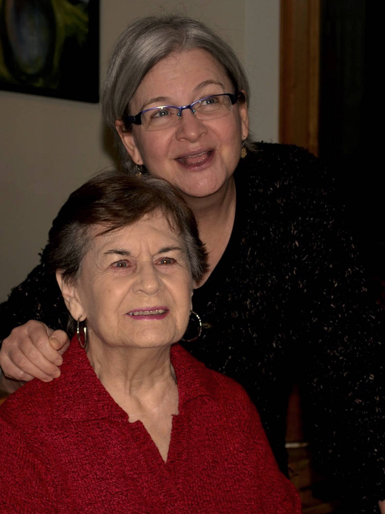 In this 2013 photo provided by Thomas Marrinson, Allison Beach, right, poses with her mother, K ...