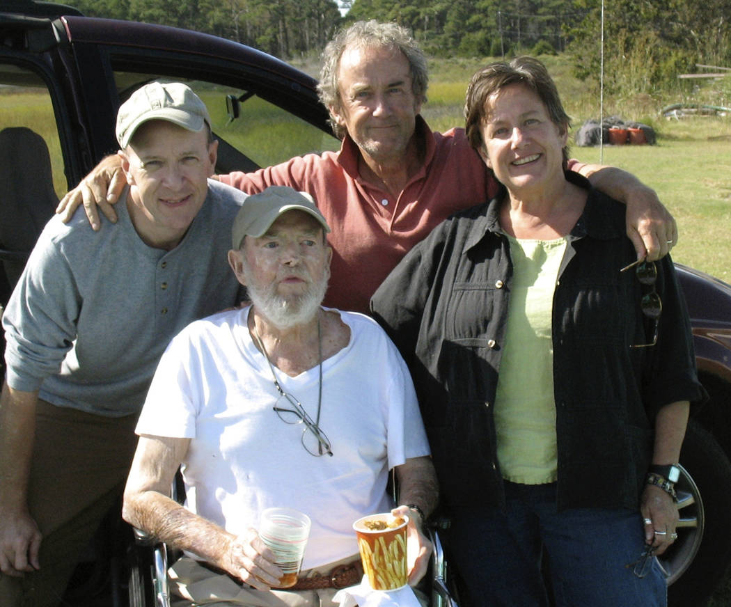 In this Sept. 29, 2009 photo provided by Betsy McNair, Robert McNair, center, poses with his ch ...