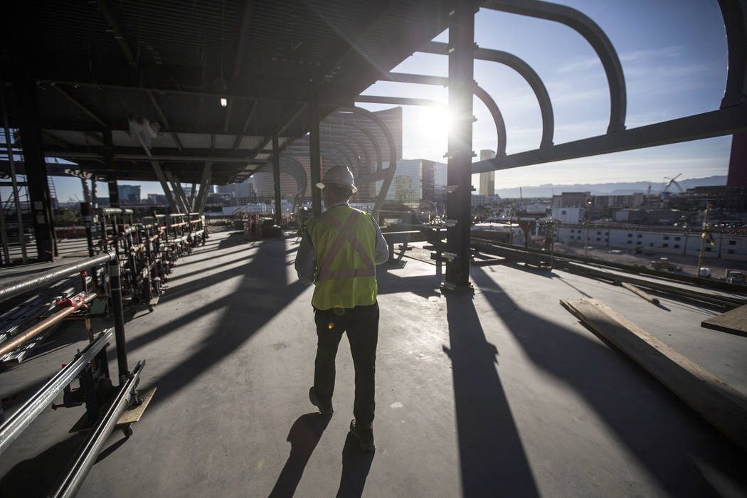 Terry Miller, owner representative with Cordell Corporation, leads a tour of the new expansion ...