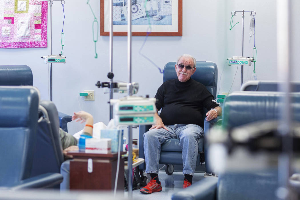 Fred Warnick, 73, the first patient in the world on a new lymphoma clinical trial, receives his ...
