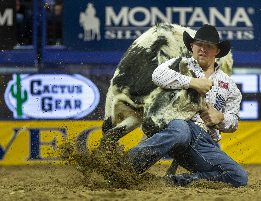 Stetson Jorgensen of Blackfoot, Idaho, turns a steer during a first place time of 3.40 seconds ...