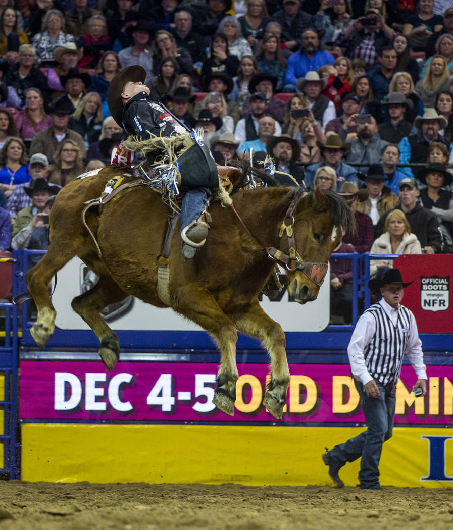 Zeke Thurston of Big Valley, Alberta, leans way back while atop of Get Smart for a first place ...