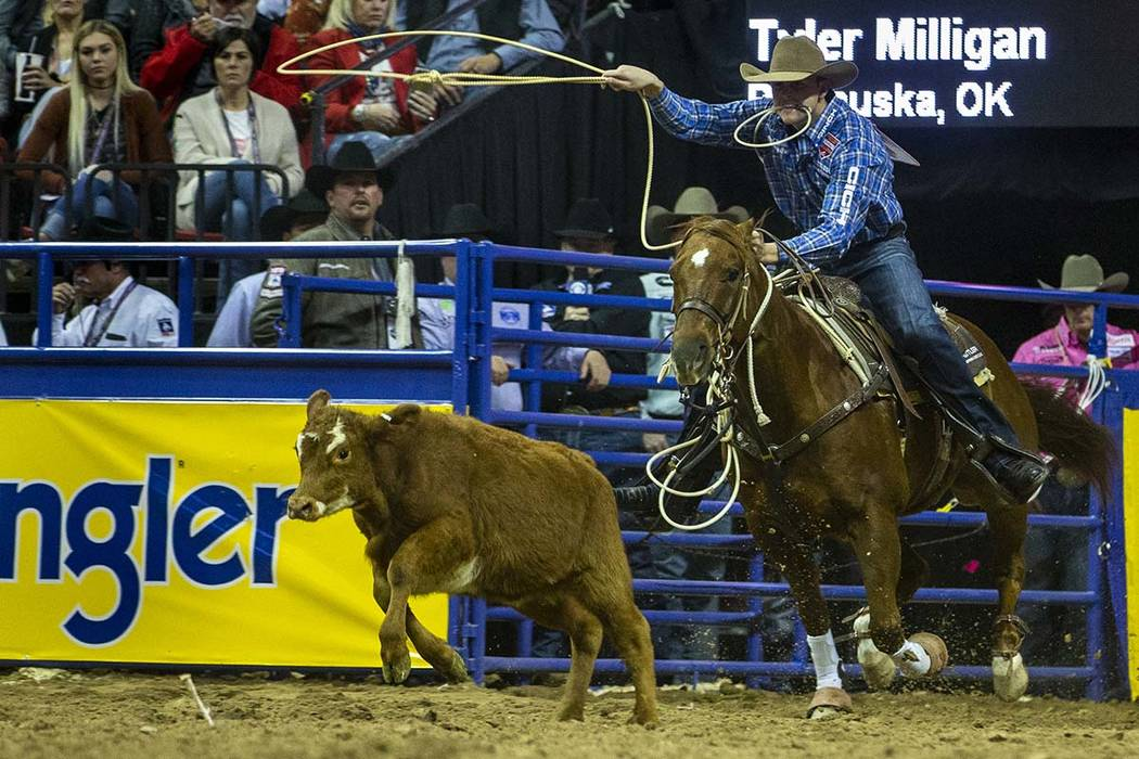 Tyler Milligan of Pawhuska, Okla., eyes a calf while on a first place time of 7.50 seconds in T ...