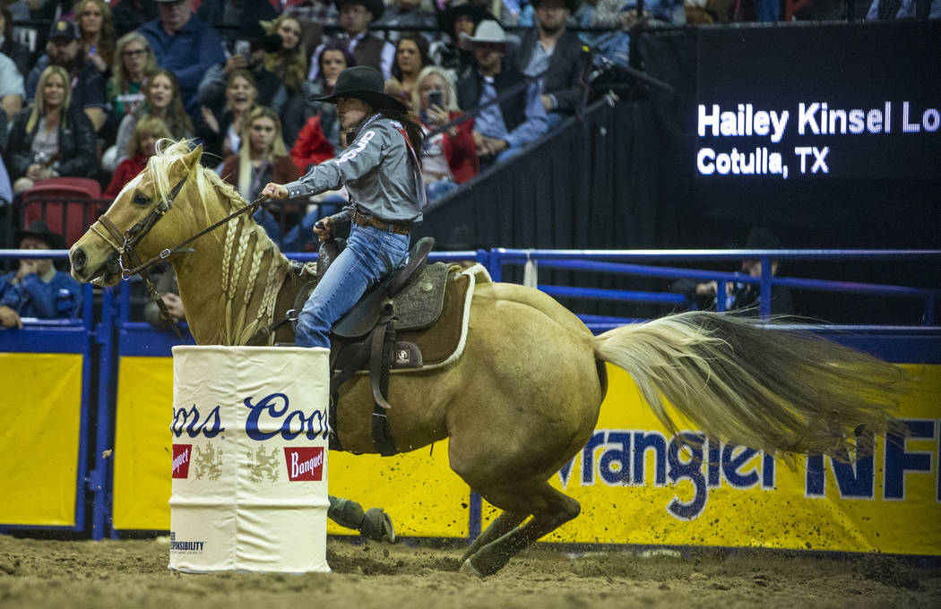 Hailey Kinsel of Cotulla, Texas, rounds a barrel on the way to a first place time of 13.60 seco ...