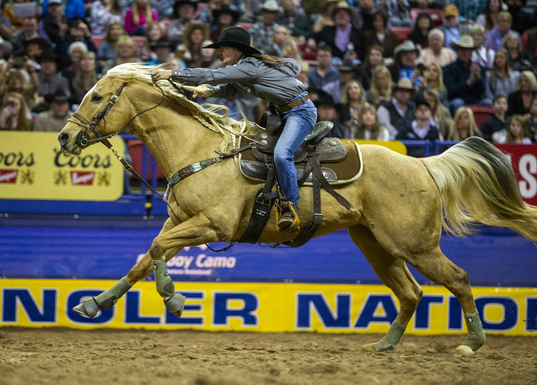 Hailey Kinsel of Cotulla, Texas, heads for home on the way to a first place time of 13.60 secon ...