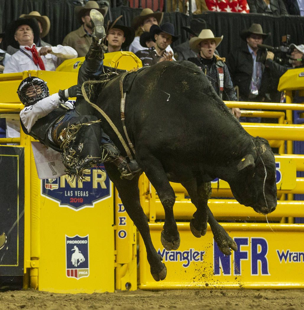 Sage Kimzey of Strong City, Okla., hangs on for time on Smoke Wagon for a first place score of ...
