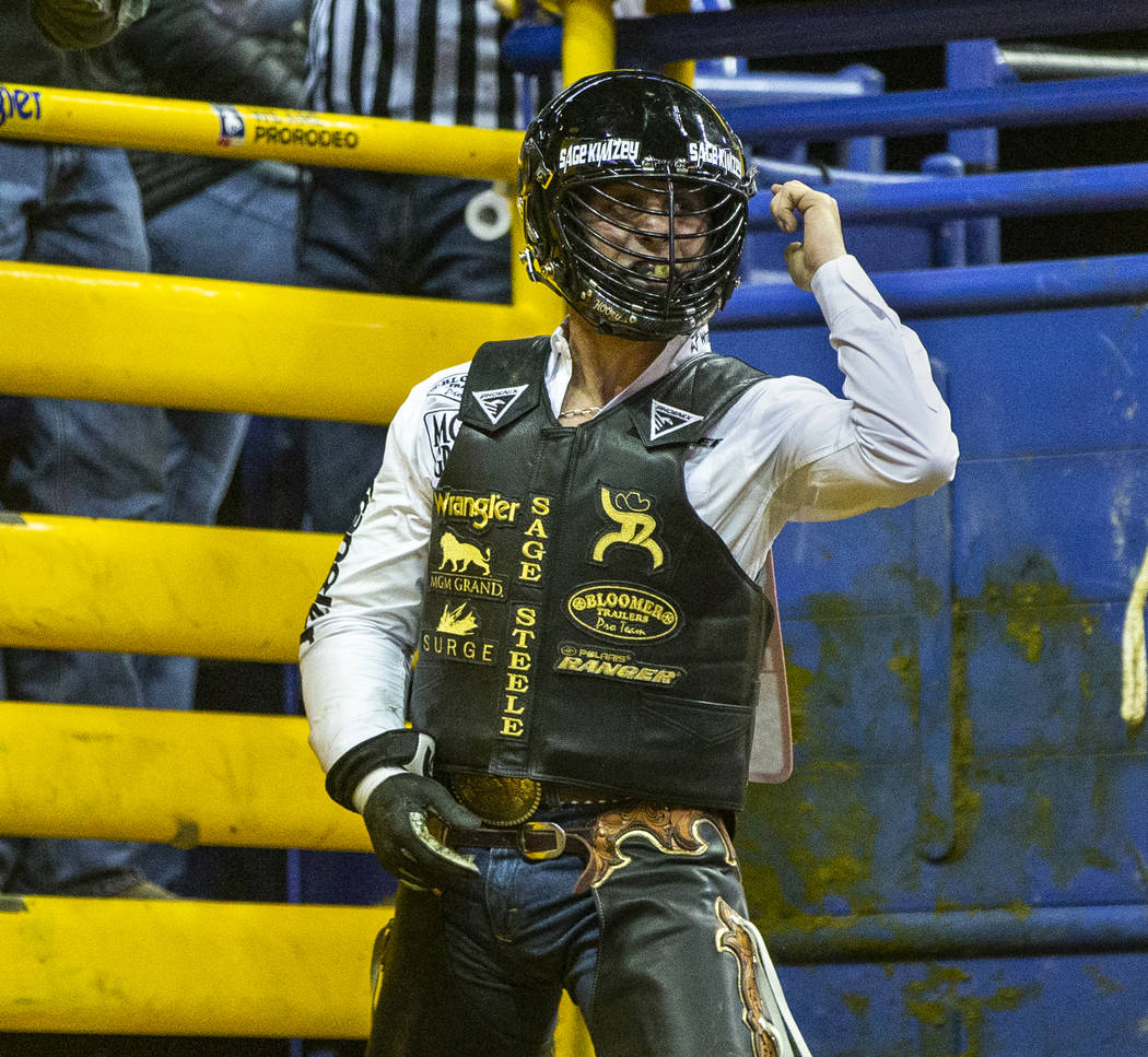 Sage Kimzey of Strong City, Okla., is pumped up after a first place score of 90 points atop of ...