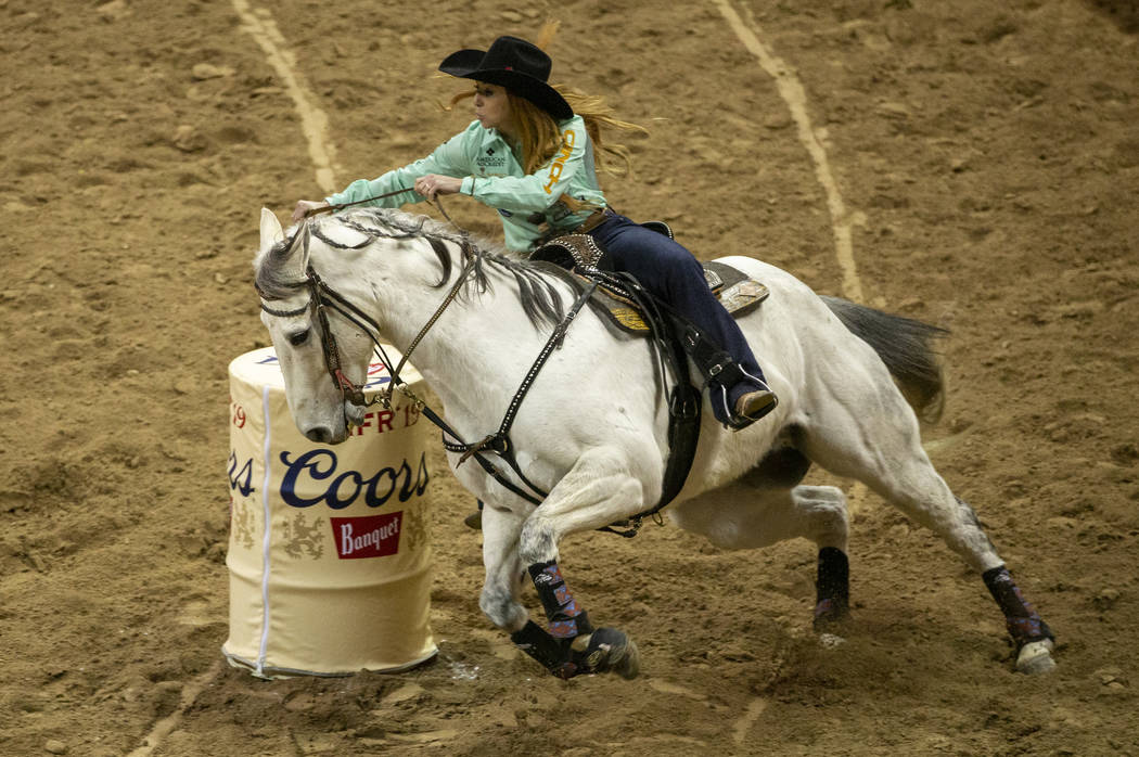 Emily Miller of Weatherford, Okla., turns the corner on her way to a time of 13.64 seconds and ...
