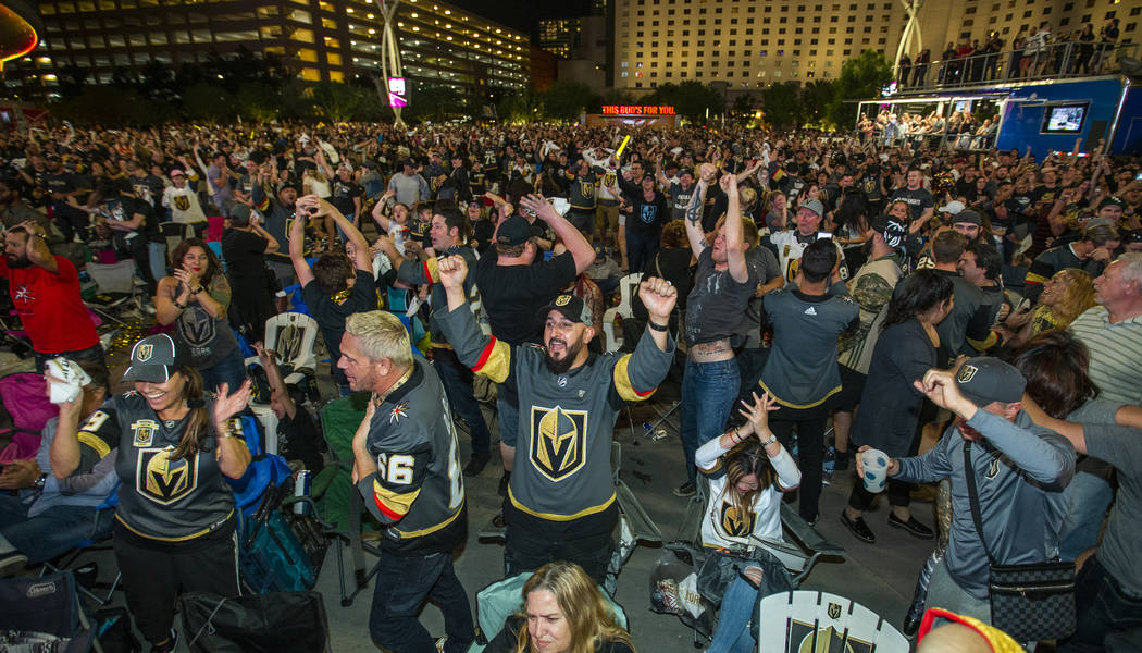 Golden Knights fan Hugo Alcala celebrates with others during a watch party at Toshiba Plaza in ...