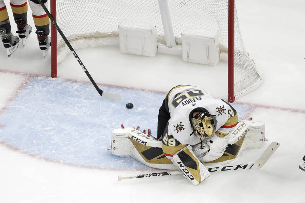 Vegas Golden Knights goaltender Marc-Andre Fleury reacts after giving up a goal to St. Louis Bl ...