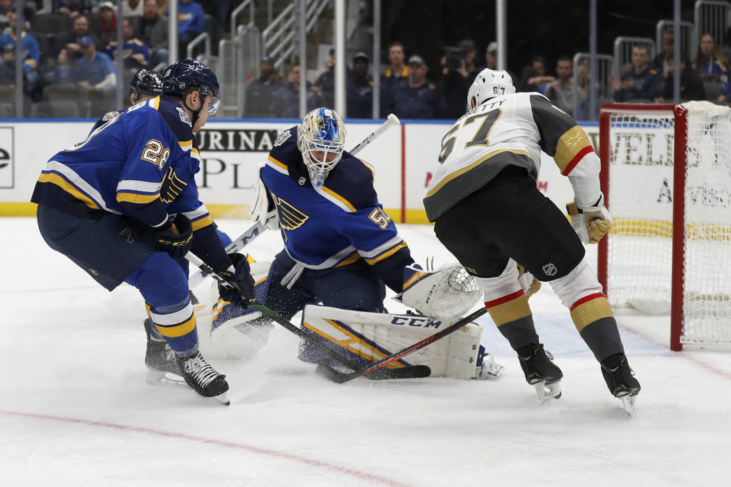 Vegas Golden Knights' Max Pacioretty, right, scores past St. Louis Blues goaltender Jordan Binn ...