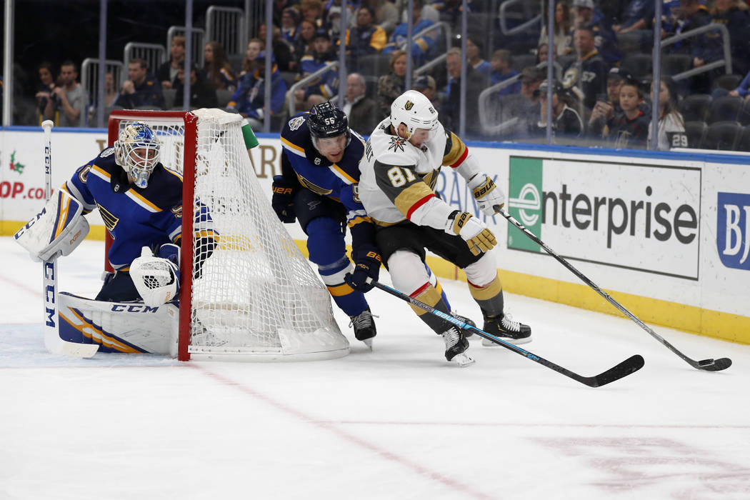 Vegas Golden Knights' Jonathan Marchessault (81) reaches for a puck as St. Louis Blues goaltend ...