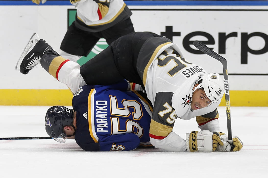 Vegas Golden Knights' Ryan Reaves (75) falls over St. Louis Blues' Colton Parayko (55) during t ...