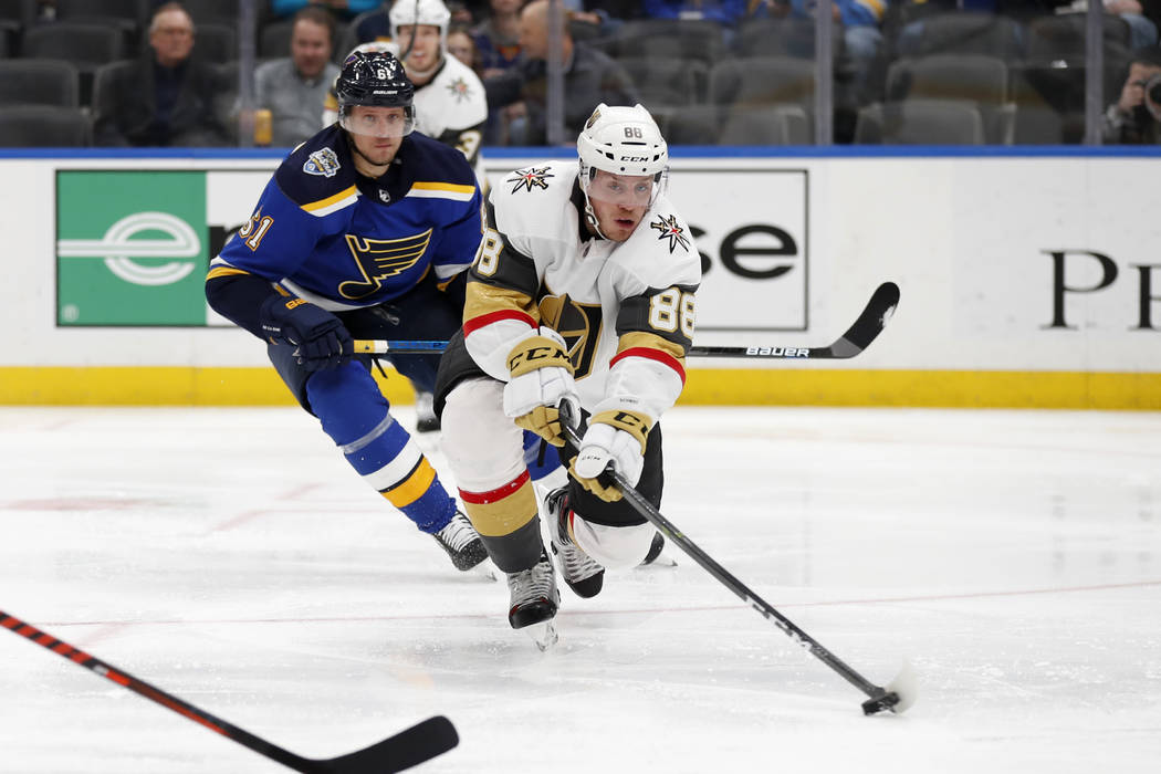 Vegas Golden Knights' Nate Schmidt (88) passes as St. Louis Blues' Jacob de la Rose, of Sweden, ...