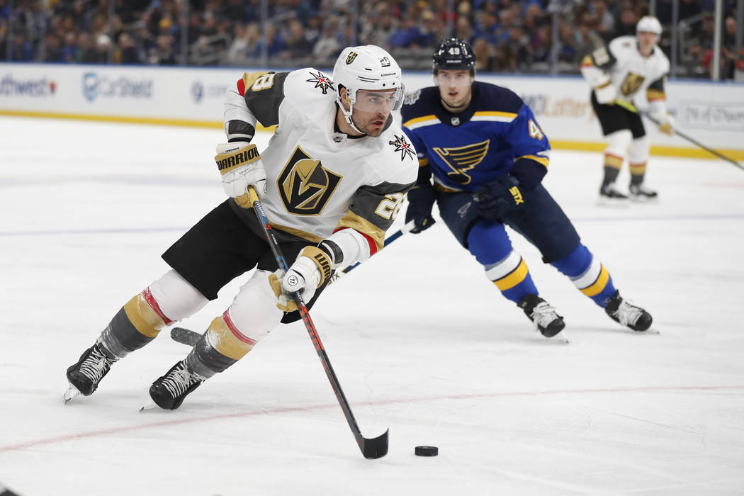 Vegas Golden Knights' William Carrier (28) handles the puck as St. Louis Blues' Ivan Barbashev ...