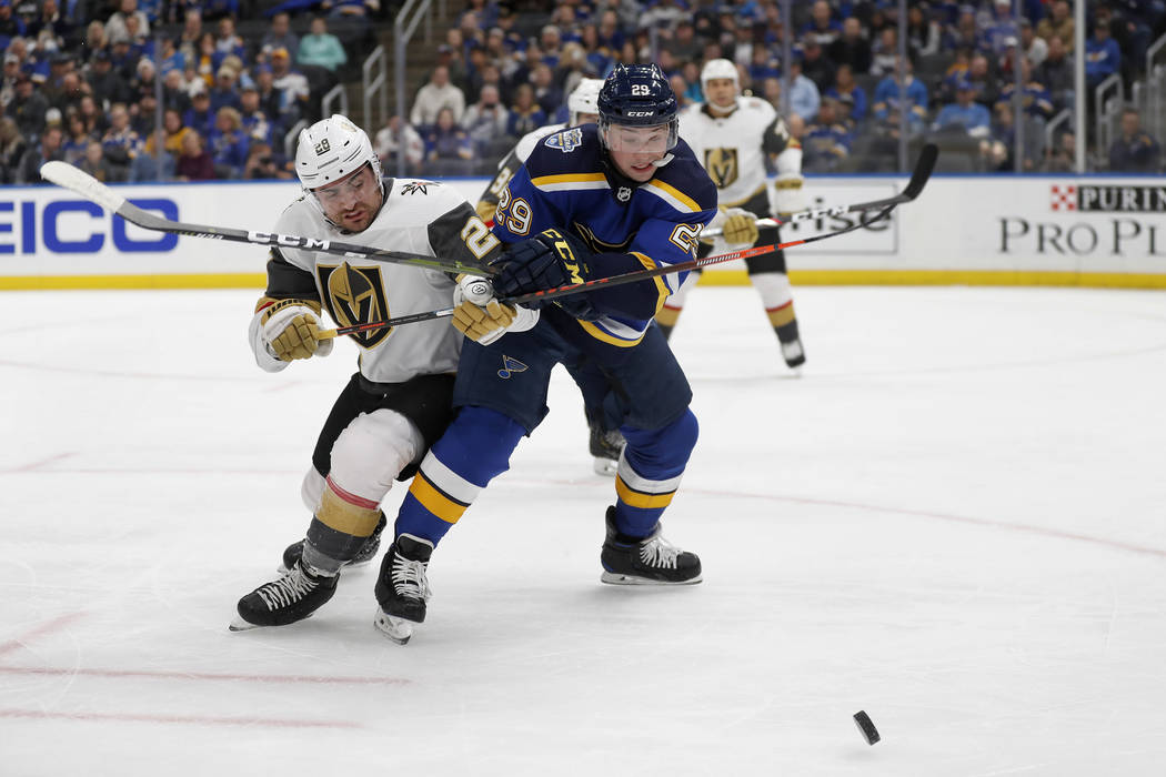 Vegas Golden Knights' William Carrier, left, and St. Louis Blues' Vince Dunn (29) chase afterth ...