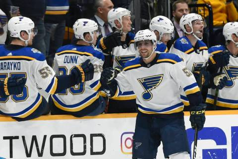 St. Louis Blues left wing David Perron (57) is congratulated after scoring against the Nashvill ...