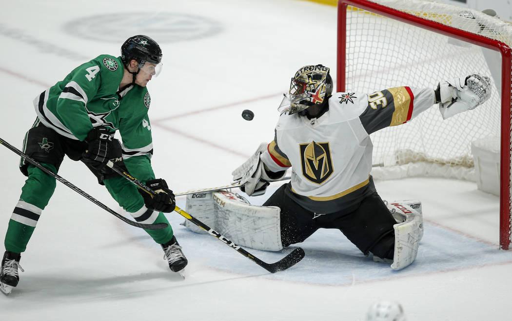 Vegas Golden Knights goaltender Malcolm Subban (30) deflects a shot from Dallas Stars defensema ...